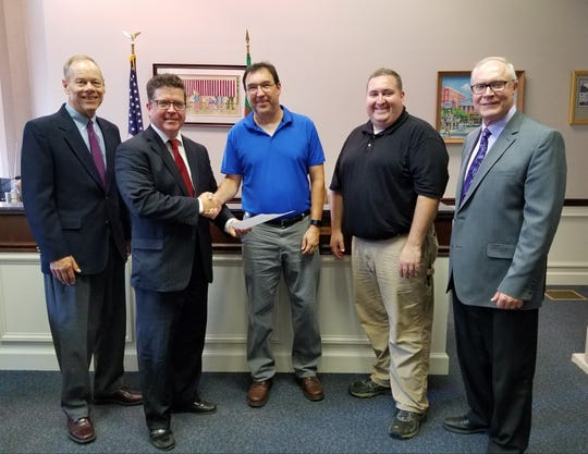 Franklin County Commissioners present CVRTC with a copy of the signed resolution authorizing the donation of a B&O rail car. From left to right: Commissioner Bob Ziobrowski, Commissioner Chairman Dave Keller, CVRTC President Garret Stahlman, CVRTC volunteer Jim Stanton and Commissioner Robert Thomas.