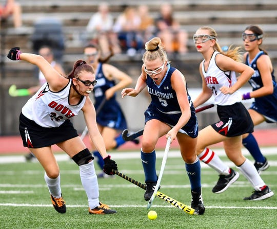 Dover's Chloe Lightner, left, and Dallastown's Lily Cantabene battle to control the ball during field hockey action at Dover Area High School in Dover Township, Thursday, Sept. 6, 2018.