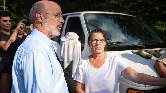 Gov. Tom Wolf meets with Amy Nevin, whose property in the Accomac area of Hellam Township was devastated by flash flooding. The heavy rains washed the bridge away that was next to Amy and Paul Nevin's home, which also took a beating.