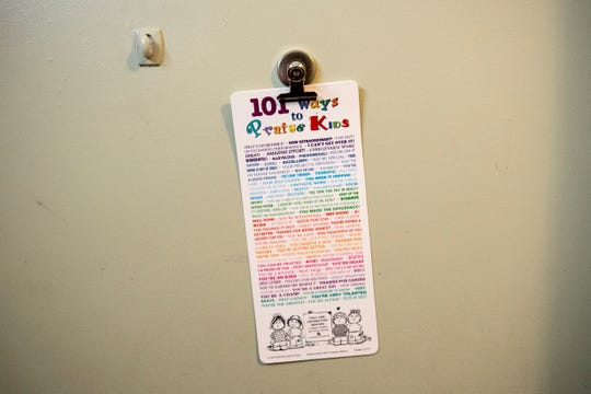 This sign, hanging on a door in the domestic abuse shelter in Gettysburg, offers 101 ways to praise children.