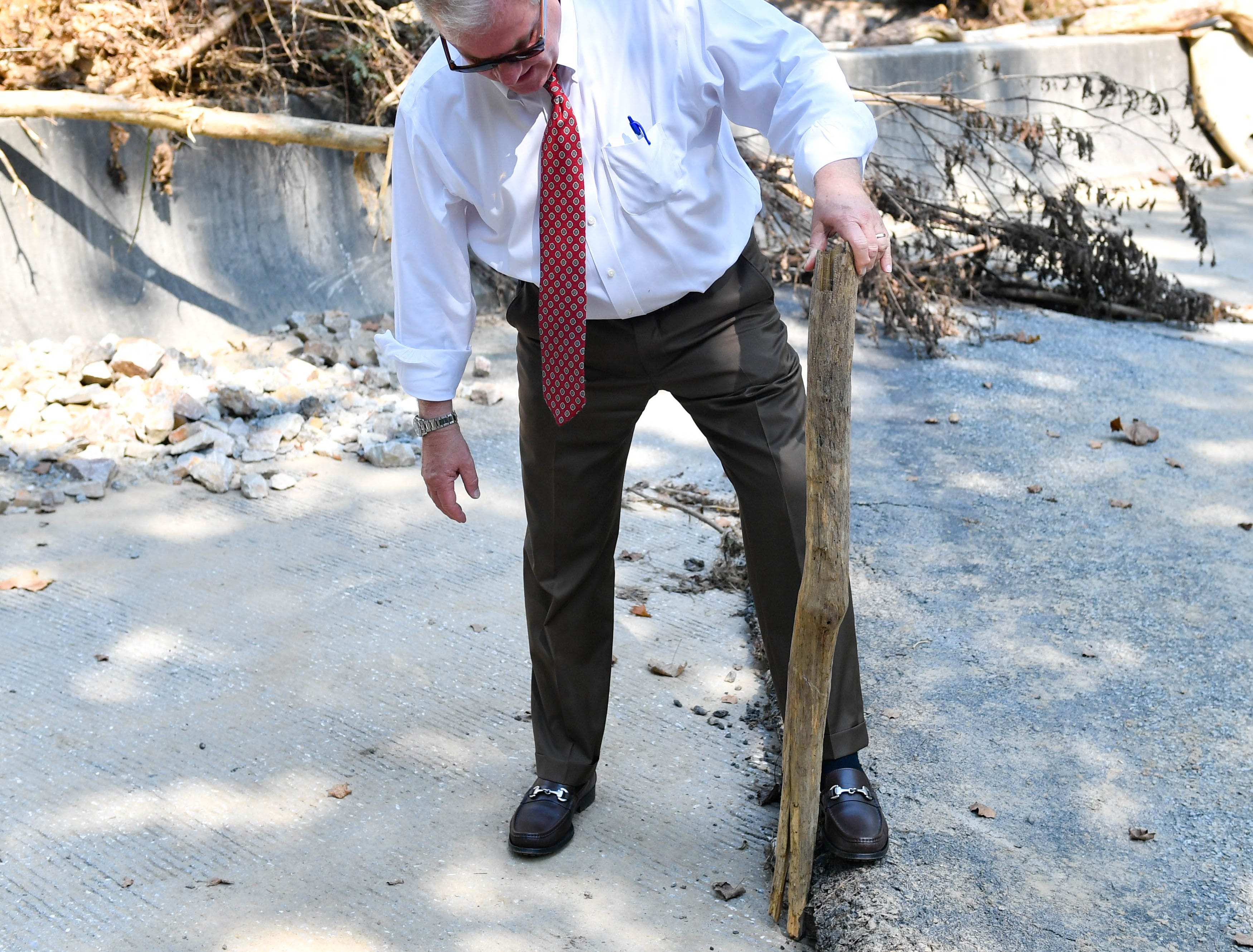 Wagner assesses the damage dealt to a bridge in Chanceford Township.