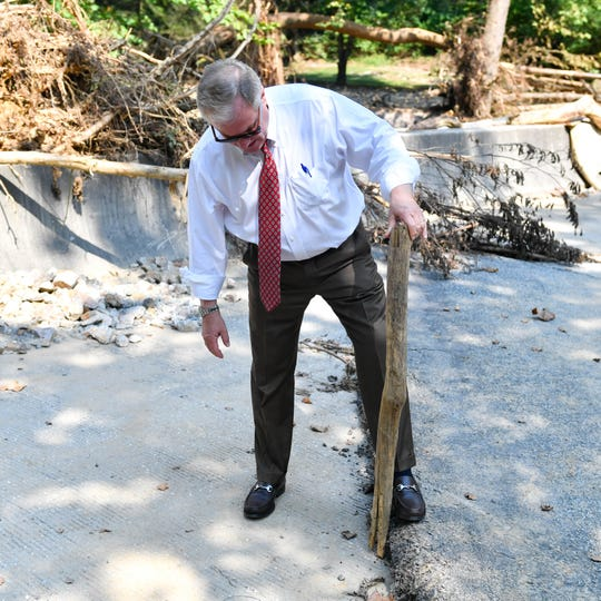 Former State Sen. Scott Wagner assesses damage to a bridge in Chanceford Township on Thursday. Wagner, the Republican candidate for governor in November's election, toured areas hard hit by flash flooding on Aug. 31.