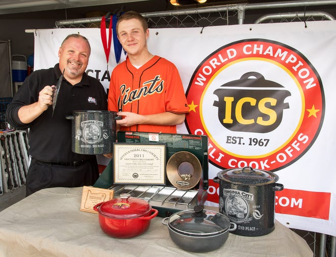 Bob Hastings and his son Daniel display the numerous awards they have won at various chili cook-off competitions.