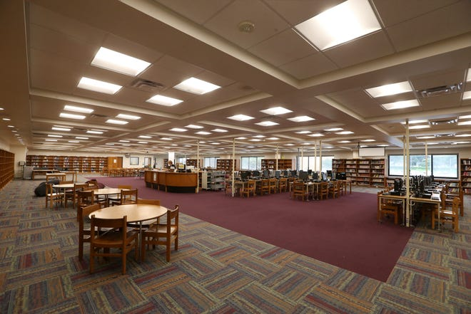 Students and staff return to a finished, remodeled library on the second floor at Greece Arcadia Middle School on the first day of school in Greece on Thursday, Sept. 6, 2018.