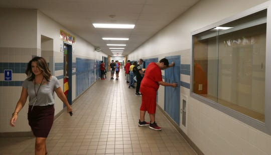 Students and staff return to a finished, remodeled hallway on the second floor at Greece Arcadia Middle School on the first day of school in Greece Thursday, Sept. 6, 2018.