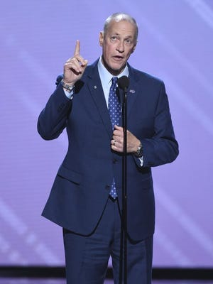 Jim Kelly accepts the Jimmy V Award for perseverance at the ESPYs in July.