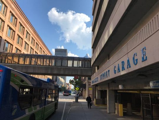 Rochester officials want to unload three city-owned parking garages, including the Mortimer Street Garage.