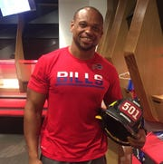 Bills linebacker Lorenzo Alexander and the fireman's helmet he wore in support of a friend in 2016. Protesting during the anthem at NFL games is back in the news with Nike using Colin Kaepernick in a new ad campaign celebrating its iconic 'Just Do It' slogan. Alexander applauded Nike for choosing the polarizing former San Francisco quarterback who has been unable to get another team to sign him.