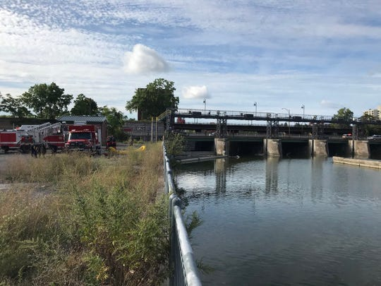 Emergency workers start the process of recovering a body found in the Genesee River north of the Andrews Street bridge and south of the Inner Loop.