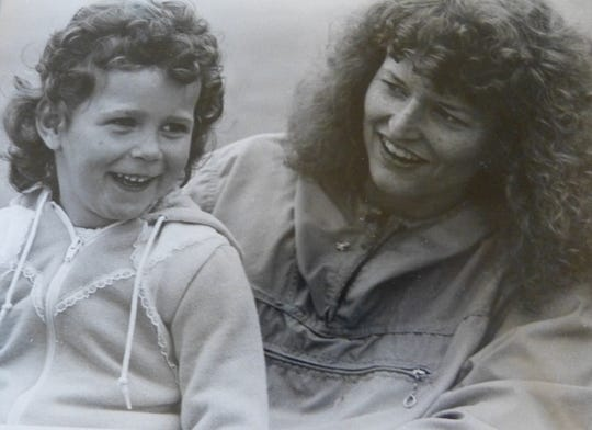 A young Kelle Clark and her mother are shown in a photo during an outing at Stinson Beach.