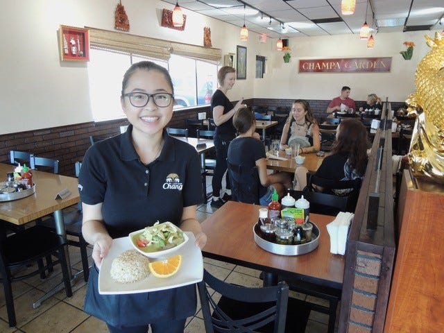 Server Rosa Saetern with a lunch special at Champa Garden in Redding.