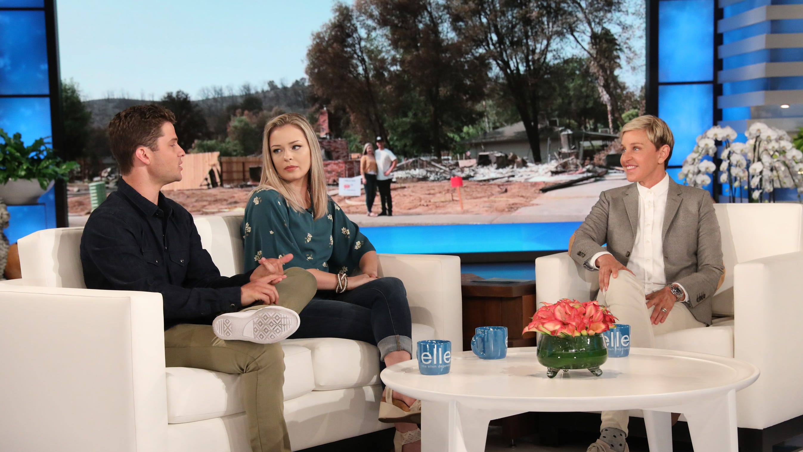 "Talk show host Ellen DeGeneres (right) interviews firefighter Eric Johnson and his girlfriend Hope Jordan on ""The Ellen DeGeneres Show."" The couple lost their Redding home in the Carr Fire."