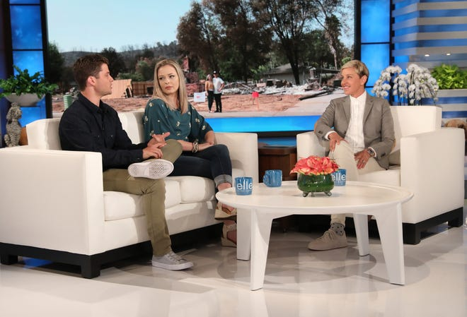 """Talk show host Ellen DeGeneres (right) interviews firefighter Eric Johnson and his girlfriend Hope Jordan on """"The Ellen DeGeneres Show."""" The couple lost their Redding home in the Carr Fire."""