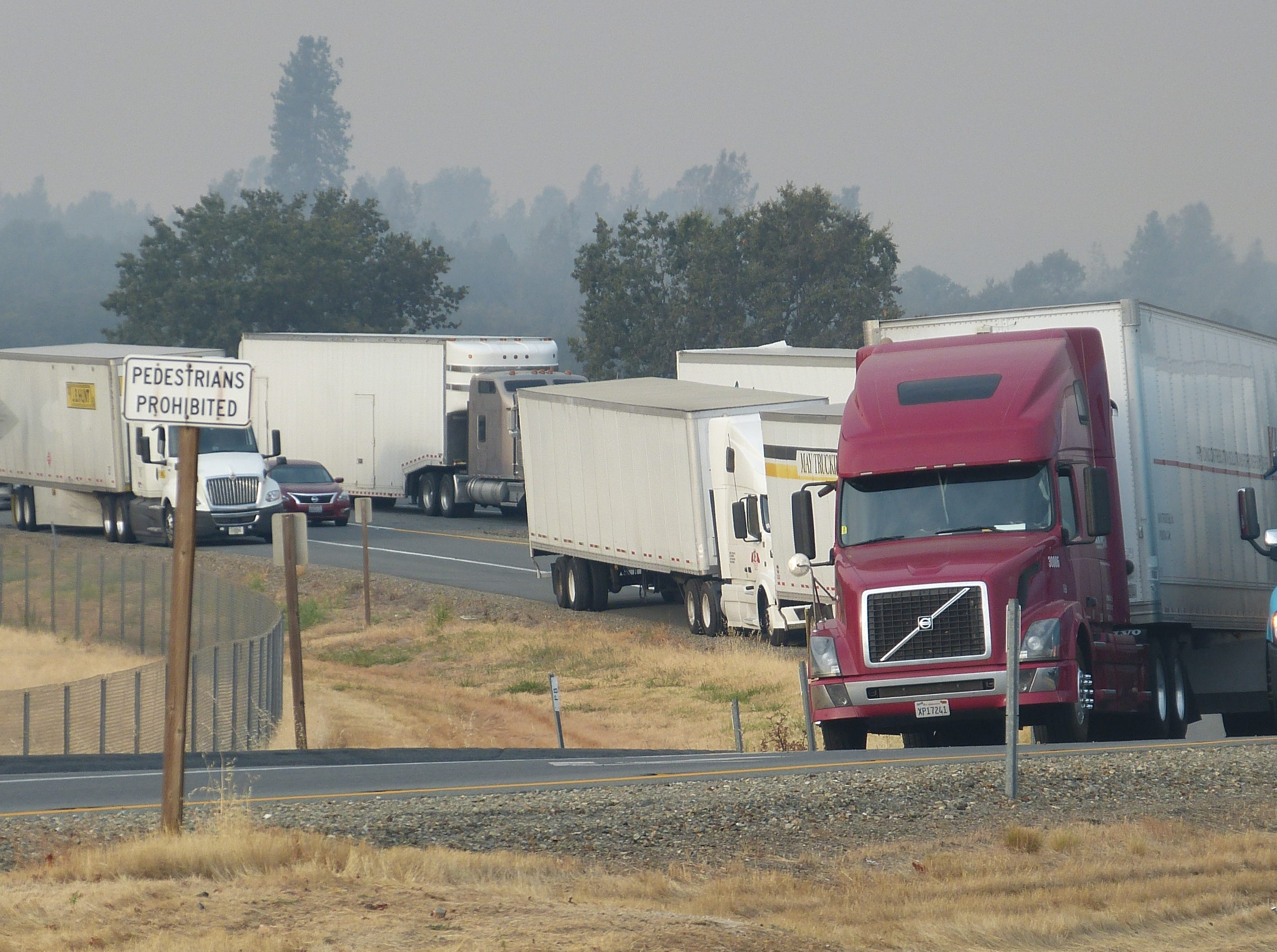 The closure of Interstate 5 due to the Delta Fire forced many truckers to wait off the freeway as they wait Thursday morning, Sept. 6, 2018, for the freeway to reopen.