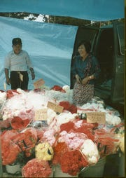 The Tashiros selling flowers. Date unknown.