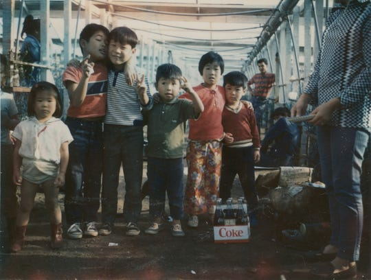 An Uchida family birthday party celebrated in their Salinas greenhouse around 1969.