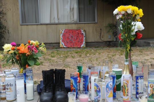 Memorial set up by friends and family of Obed Osornio, 24, near where he was shot and killed around midnight on Saturday.