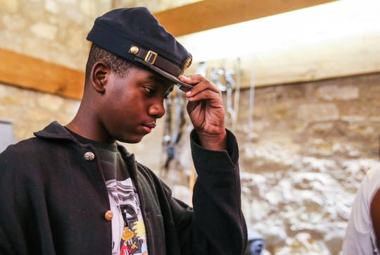 Jaborien Cook, 14, put on a Buffalo Soldier cap while getting ready for Museum Day Saturday Sept. 1, 2018, at Fort Concho.