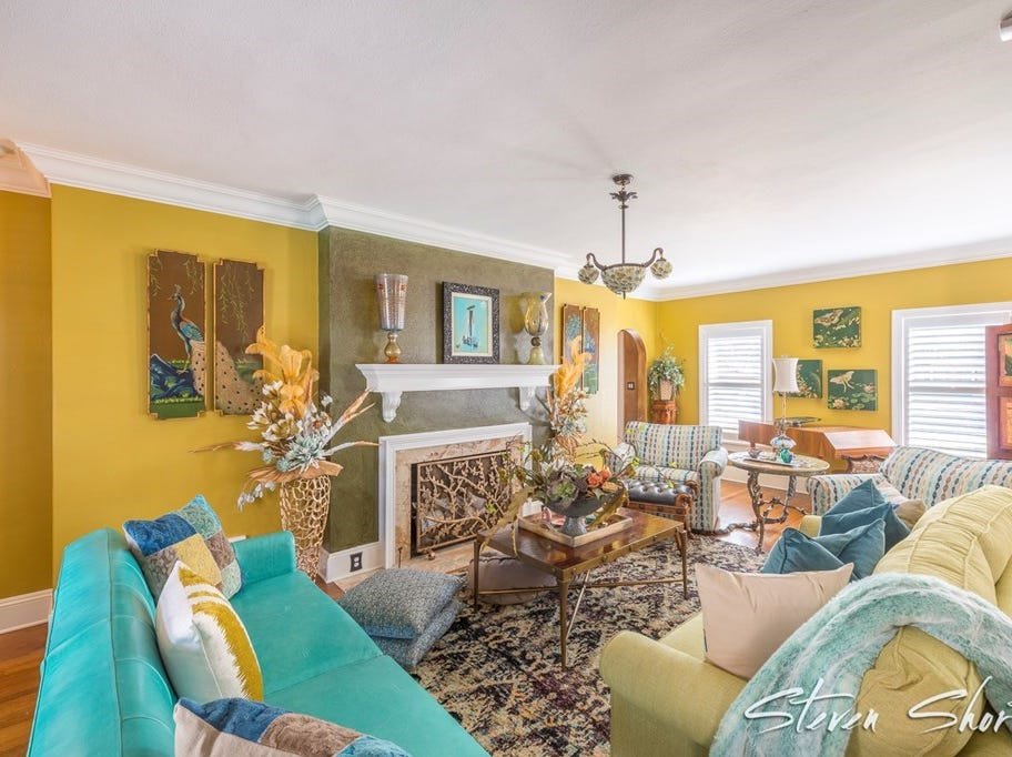 The living space at 1315 S Madison shows no fear of color with its blue and yellow theme.