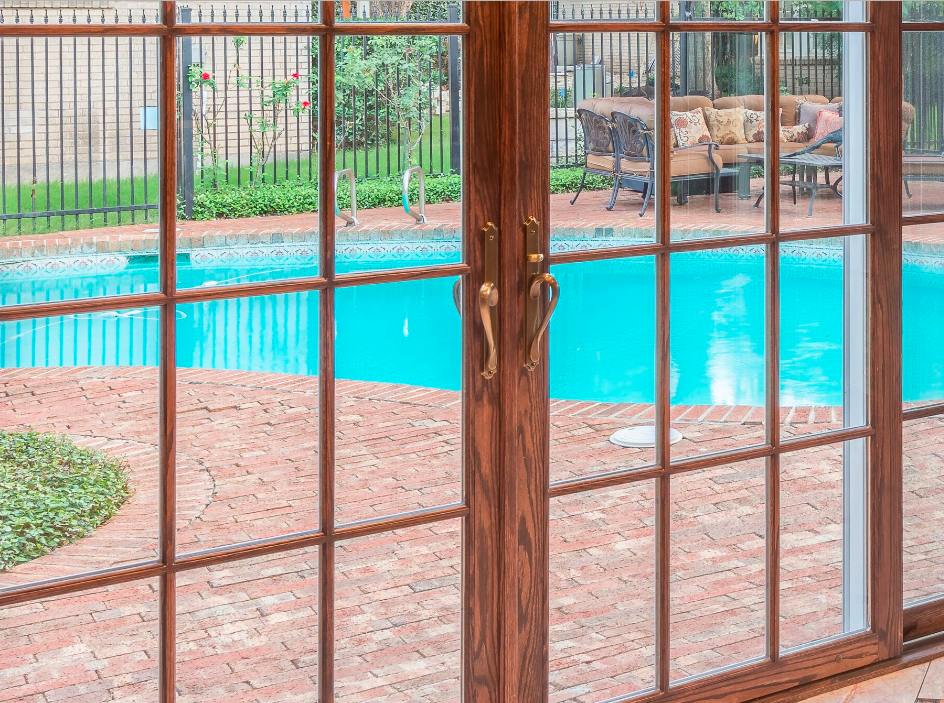 The den has two walls of French doors that lead into the fenced in pool.