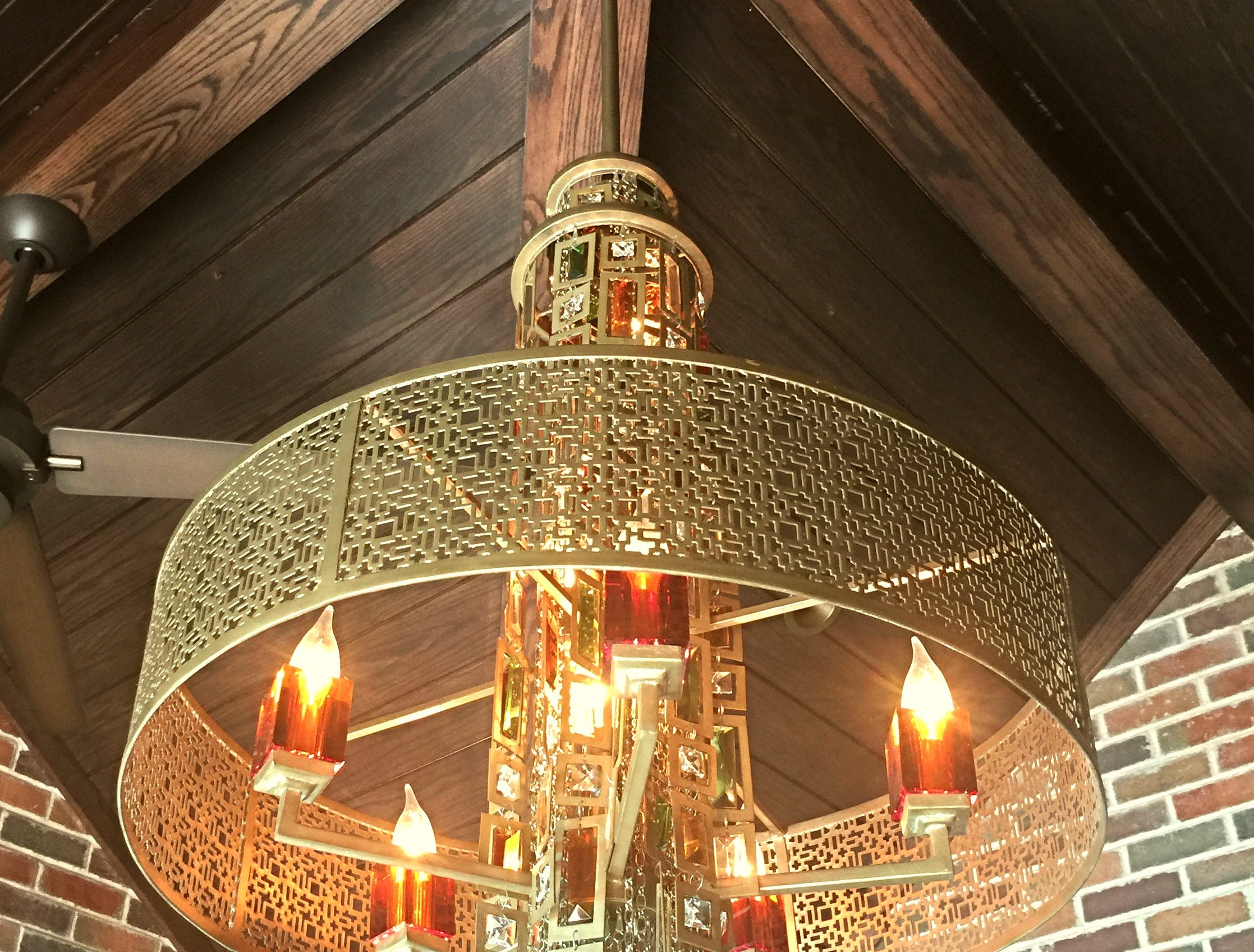 This chandelier in the den of 1315 S Madison continues the trend of detailed work with classic style.