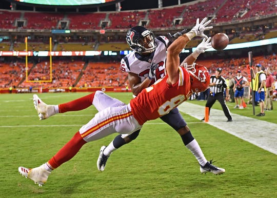 Cornerback Josh Thornton #36 of the Houston Texans bakes up a pass in the end zone intended for tight end Alex Ellis #82 of the Kansas City Chiefs during the second half on August 9, 2018 at Arrowhead Stadium in Kansas City, Missouri. Ellis is a graduate of Delmar High School.