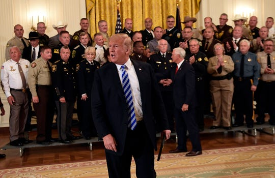 President Donald Trump responds to a reporters question during an event with sheriffs in the East Room of the White House in Washington, Wednesday, Sept. 5, 2018.