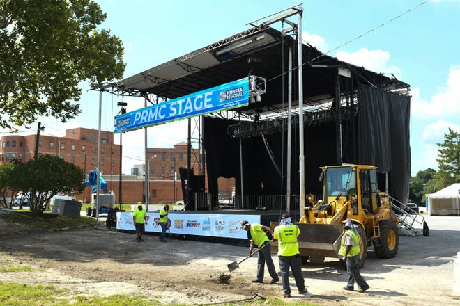 City workers help put final touches on the PRMC Stage area before the beginning of the National Folk Festival on Thursday, Sept 6, 2018.