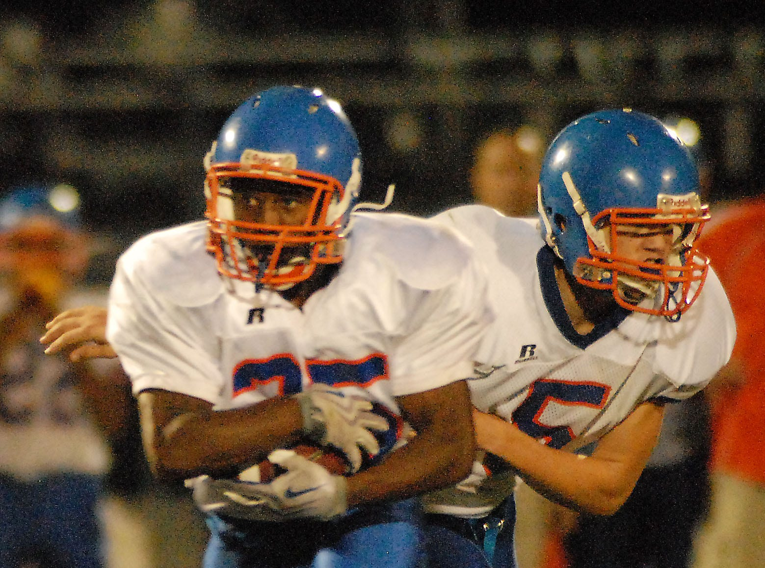 Then Delmar junior Alex Ellis (#5) hands the ball off to Bryan Daniels in 2009. Ellis now plays tight end for the Kansas City Chiefs.