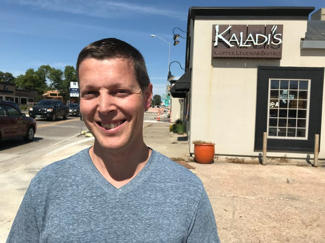 Mark Gillespie, co-owner of Kaladi's Bistro, poses for a portrait outside of his business.