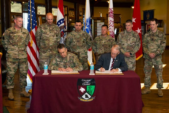 Maj. Gen. Stephen L. Danner, the adjutant general of Missouri, and College of the Ozarks President Jerry Davis sign the agreement for the new commissioning program in a brief ceremony today, Sept. 5, 2018, at C of O.