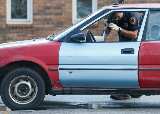 Police officers investigate the scene of an apparent road rage related shooting on Thursday, Sept. 6, 2018 that started near Division Street and West Bypass and ended on Boonville Avenue near the Greene County Jail, where the police took the suspect into custody.