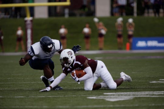 Missouri State running back Jason Randall appears to have control of the ball with at least one knee on the ground during the Bears' home opener against Lincoln. Randall later lost the ball and it was called a fumble.