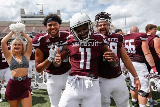 From left, Elijah Farr, Tyler Currie and Aaron Clardy celebrate the Missouri State Bears 52-24 win in their home opener at Plaster Stadium against Lincoln University on Thursday, Sep. 6, 2018.