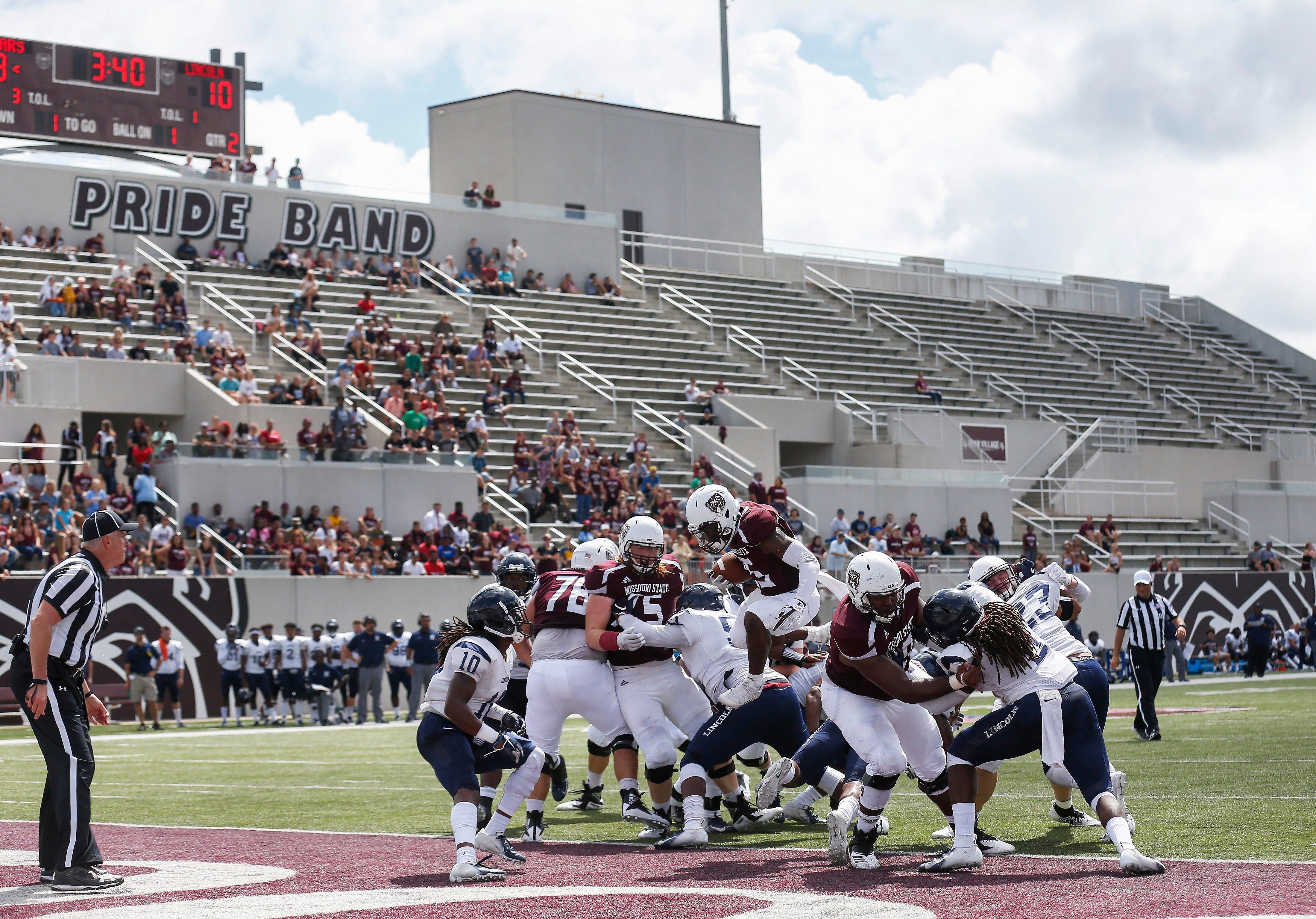 Jason Randall, of Missouri State University, leaps into the endzone during the Bears' home opener at Plaster Stadium against Lincoln University on Thursday, Sep. 6, 2018.