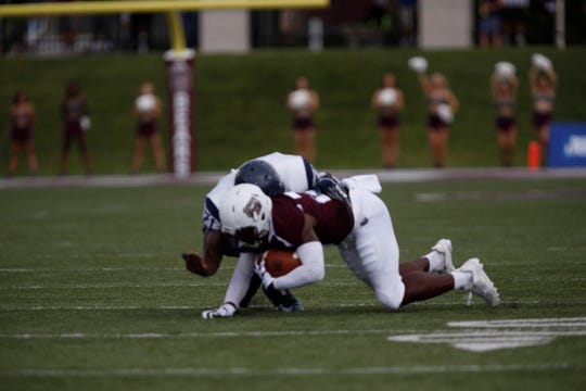 Missouri State running back Jason Randall is tackled on a play in the first quarter of the Bears' home opener vs. Lincoln. Randall lost control of the ball and it was returned for a Lincoln touchdown.