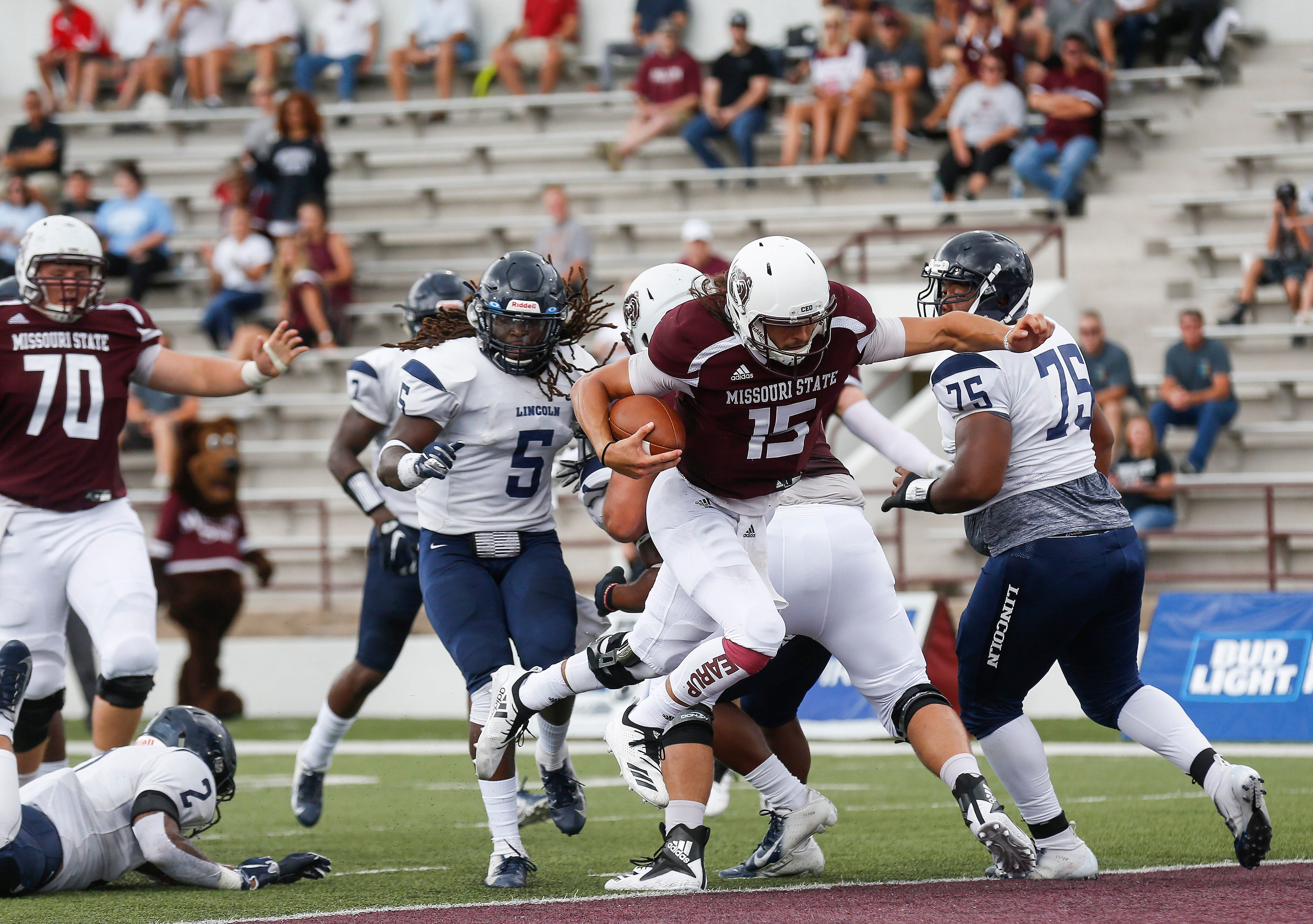 Peyton Huslig, of Missouri State, runs the ball in for a touchdown during the Bears' home opener at Plaster Stadium against Lincoln University on Thursday, Sep. 6, 2018.