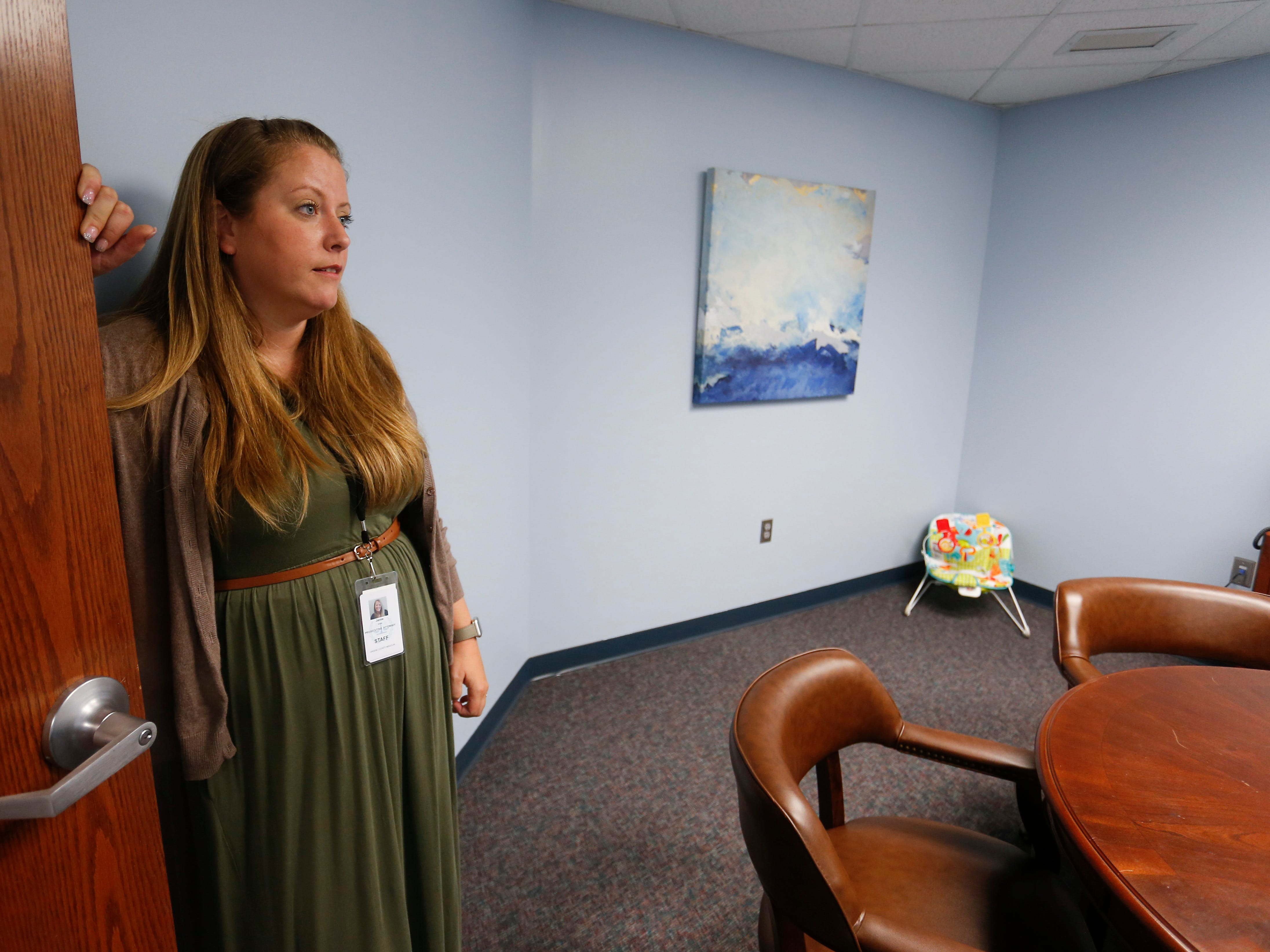 Jamie Willis, the Family Justice Center project coordinator, leads a tour of the Family Justice Center located on the second floor of the Greene County Courthouse on Thursday, Aug. 30, 2018.