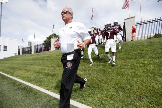 Coach Dave Steckel leads Missouri State onto the field for the team's home opener against Lincoln.