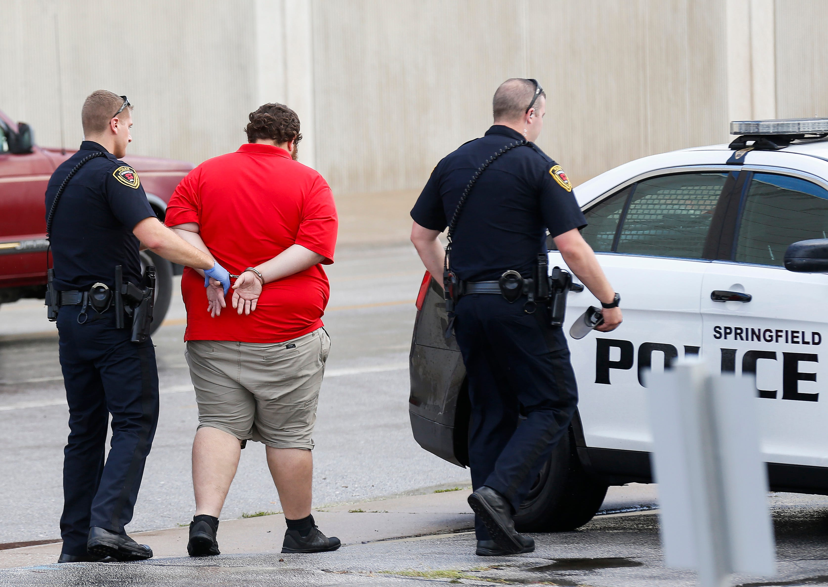 Police officers take a suspect in an apparent road rage related shooting into custody on Thursday, Sept. 6, 2018. The shooting occurred near Division Street and West Bypass, but the victim followed the suspect to Boonville Avenue near the Greene County Jail, where the police took the suspect into custody.