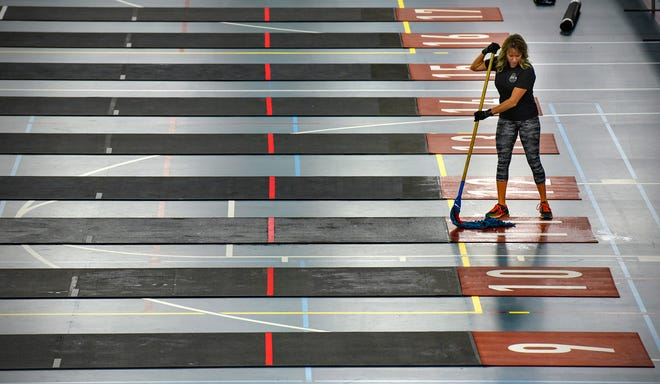 Heidi Heun prepares lanes for competition Thursday, Sept. 6, in advance of the Kill Cliff Granite Games at the field house at St. Cloud State University. The weekend event is expected to draw about 2,000 competitors ages 14-65.