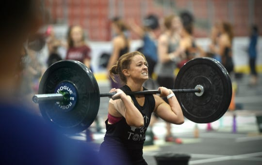 A competitor concentrates while lifting weights during an event as part of the 2016 Kill Cliff Granite Games at St. Cloud State University.
