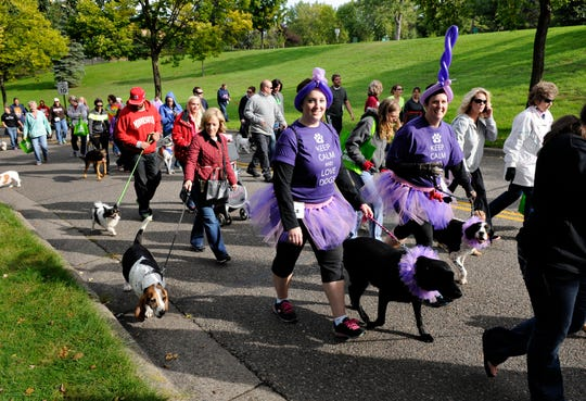 Pet owners set off on the 5k Companion Walk fundraiser for the Tri-County Humane Society from Wilson Park  in September 2014.