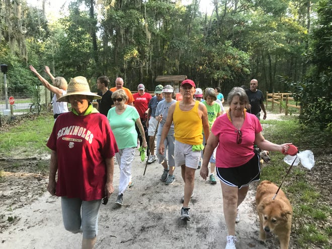 Move walkers headed out on the Lake Overstreet Trail.