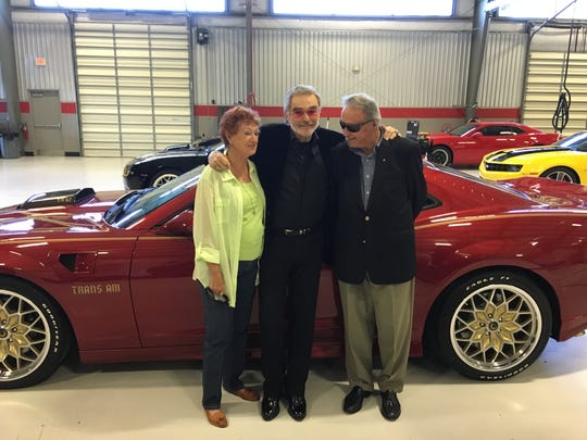 Sue Hall, Burt Reynolds, and Bobby Bowden at Trans Am Worldwide on Aviation Boulevard near the Tallahassee Regional Airport.