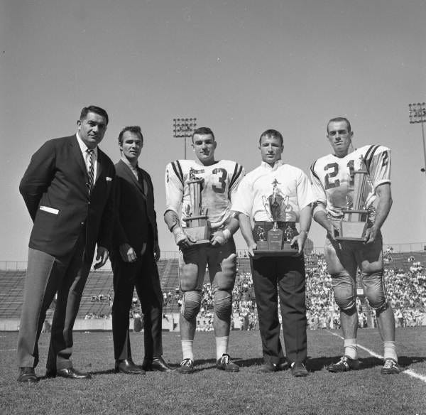 Burt Reynolds at awards ceremony during the garnet and gold football game in 1963.