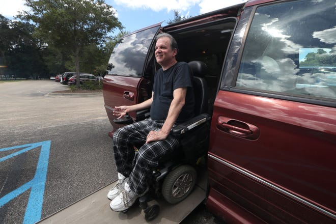 Dale Beene, a quadriplegic and musician sits on the ramp of a modified van he inherited, that has been customized to allow him to drive. Beene was injured after a fall three years ago, partially caused by Syringomyelia, a rare disorder that effects the spinal cord and says the gift of the van has changed his life.