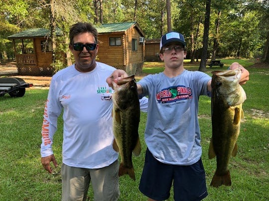 Roy Chapman (L) and Jacob Ross with two of the 10 bass they caught on Lake Seminole with guide Paul Tyre.