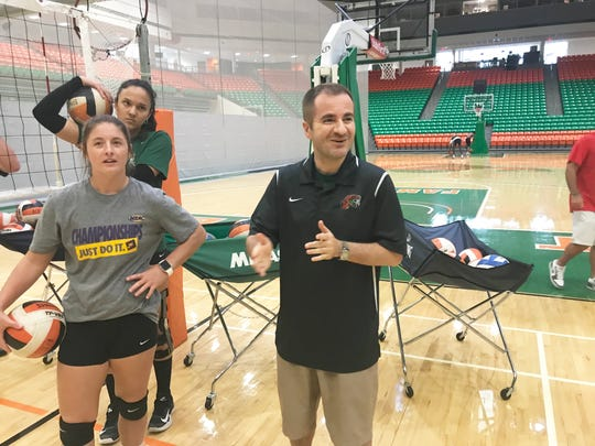 FAMU volleyball coach Gokhan Yilmaz (right) and libero Jessa Long observe the flow of practice.