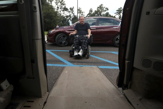 Dale Beene, is a quadriplegic and musician inherited a van that has been customized to allow him to drive, seen here with the vehicle on Wednesday, Aug. 29, 2018. Beene was injured after a fall three years ago, partially caused by Syringomyelia, a rare disorder that effects the spinal cord.